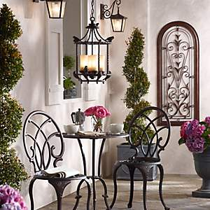 Porch Sitting In Style With A Beautiful Hanging Fixture And Wall Lanterns