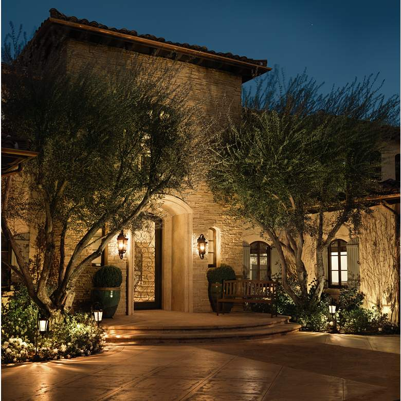 "Casa Marseille™ 21 1/2"" High Bronze Outdoor Wall Light in scene"