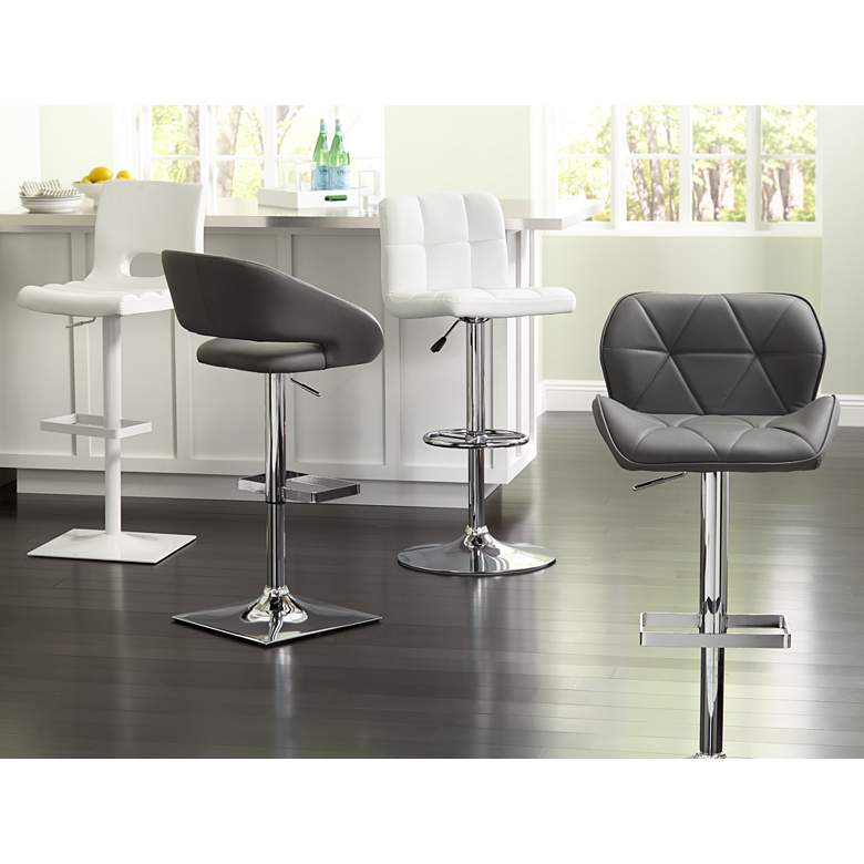 Donovan White Faux Leather Adjustable Barstool in scene