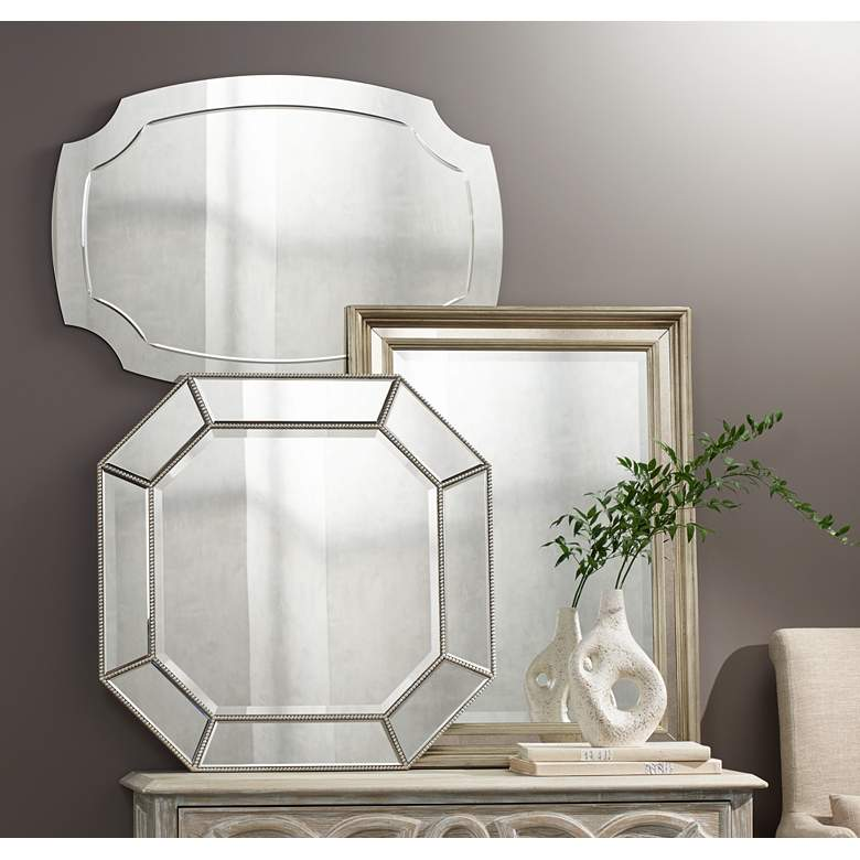 "Pajaro Black 27 1/2"" x 39 1/2"" Oval Cut Wall Mirror in scene"