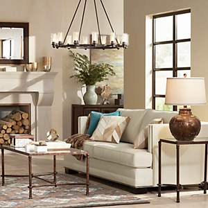 a large chandelier anchors a cozy living room with rustic touches - Chandelier Living Room Ideas