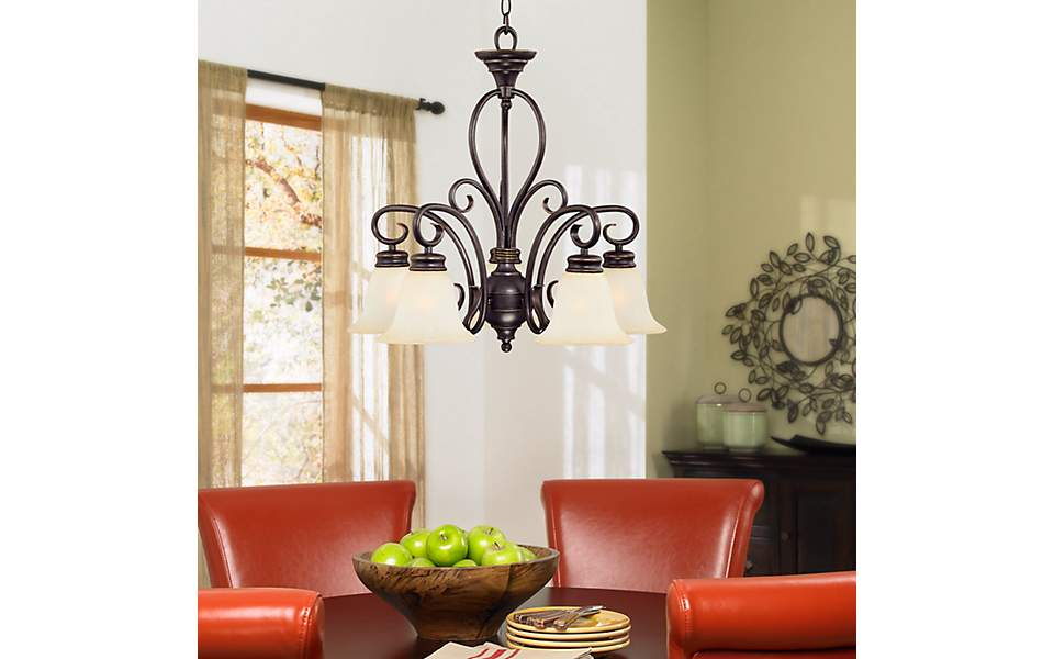 A Downlight Chandelier Lights A Round Dining Room Table