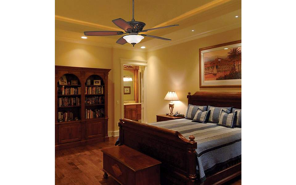 Masculine bedroom design with ceiling fan.