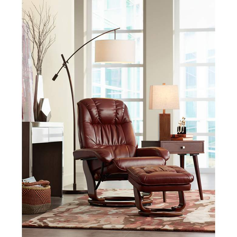 Kyle Ruby Red Faux Leather Ottoman and Swiveling Recliner in scene