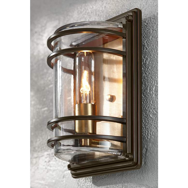 "Habitat 11"" High Bronze and Warm Brass Outdoor Wall Light in scene"