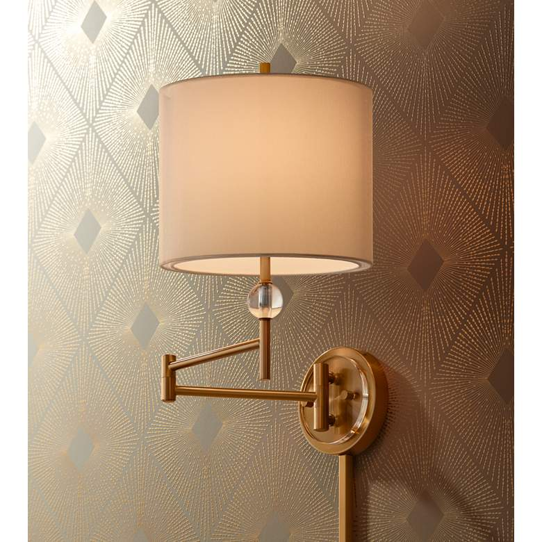 Kohle Brass and Acrylic Ball Swing Arm Plug-In Wall Lamp in scene