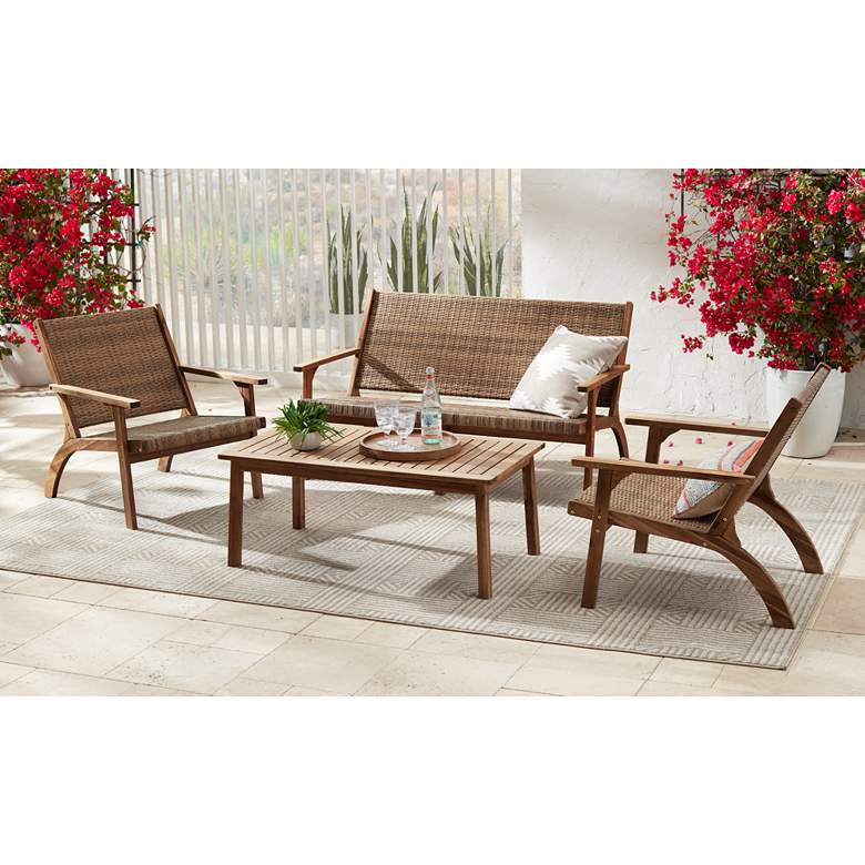 "Perry 55 1/4"" Wide Natural Wood Outdoor Sofa in scene"