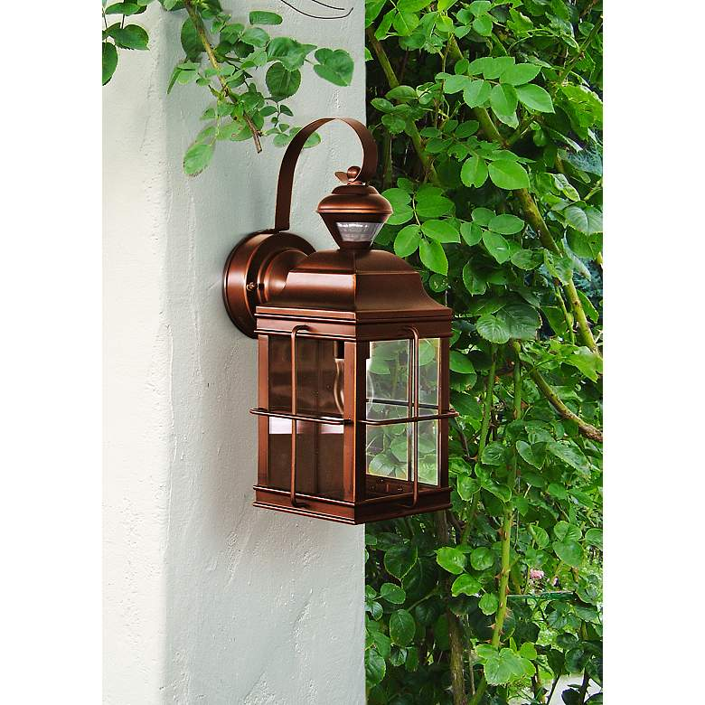 "Carriage Bronze 14 3/4"" High Motion Sensor Outdoor Light in scene"