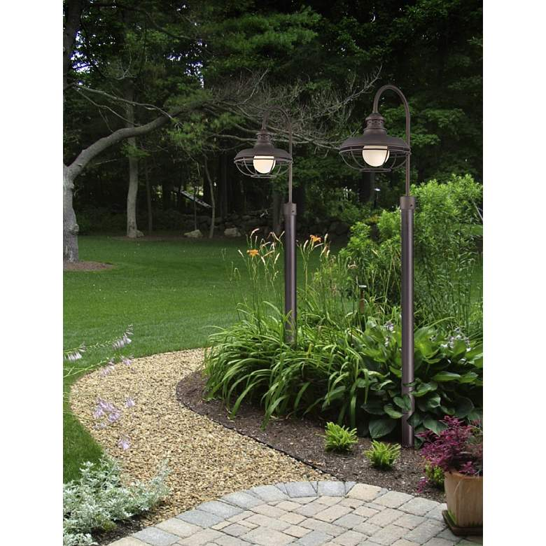 "Franklin Park 23 1/2"" High Bronze Cage Outdoor Post Light in scene"