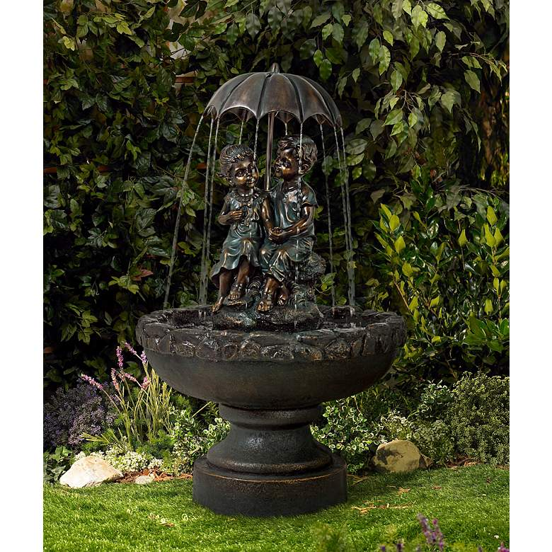 "Boy and Girl Under Umbrella 40"" High Indoor/Outdoor Fountain in scene"
