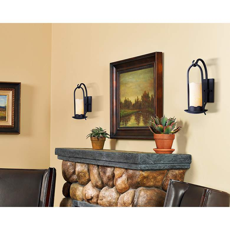 Hanging Onyx Faux Candle Wall Sconce in scene