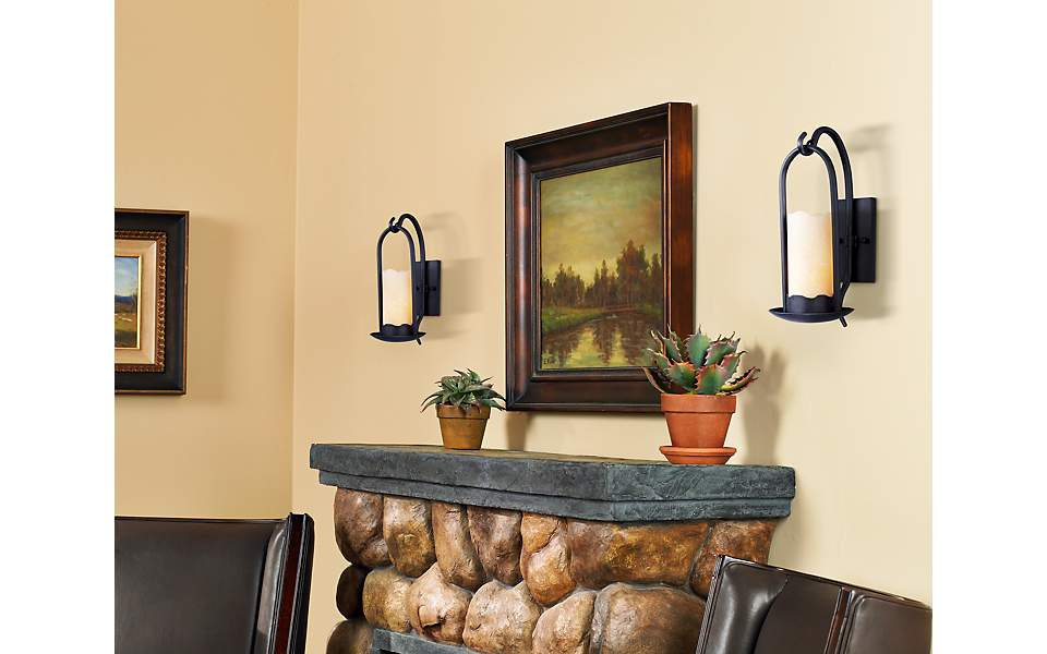 Rustic Wall Sconces Brighten A Living Room Fireplace