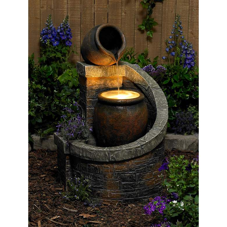 "Verona 35"" High Rustic Brick Garden Fountain with LED Light in scene"