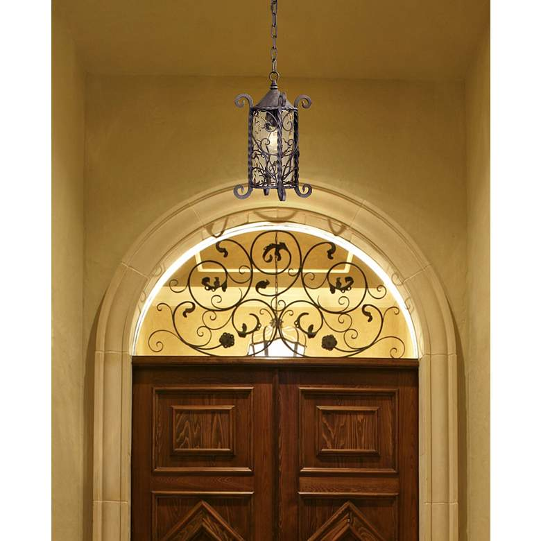 "Casa Seville 15"" High Walnut Scroll Outdoor Hanging Light in scene"