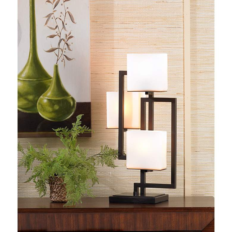 Lighting on the Square Roman Bronze Metal Accent Table Lamp in scene
