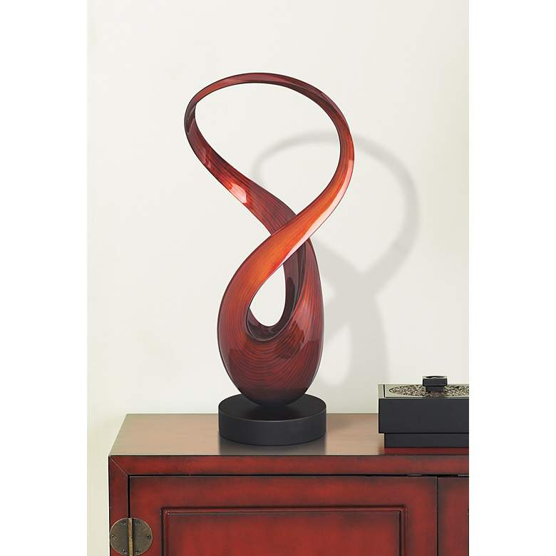 Autumn Orange Figure 8 Lacquered Twist Sculpture in scene