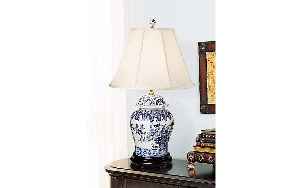 An Entryway Table With A Ceramic Ginger Jar Table Lamp