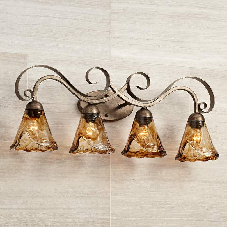 "Amber Scroll 29 1/2"" Wide Art Glass and Bronze Bath Light in scene"