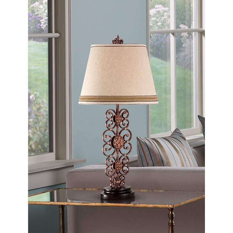 Metal Scroll Medallion Table Lamp in scene