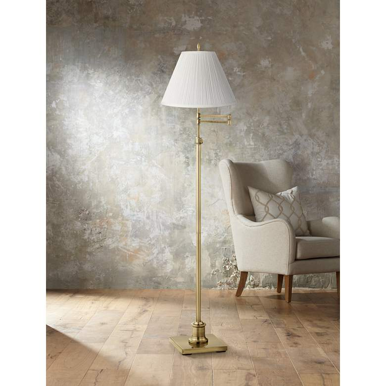 Westbury White Pleated Shade Brass Swing Arm Floor Lamp in scene